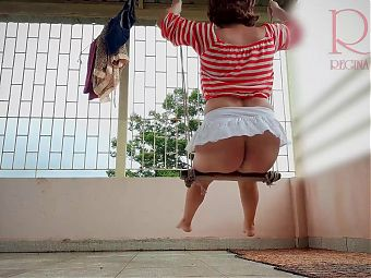 Maid outdoors have no panties on a swing retro