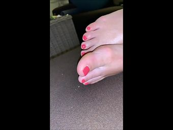 sexy bare feet of my wife with red toenails